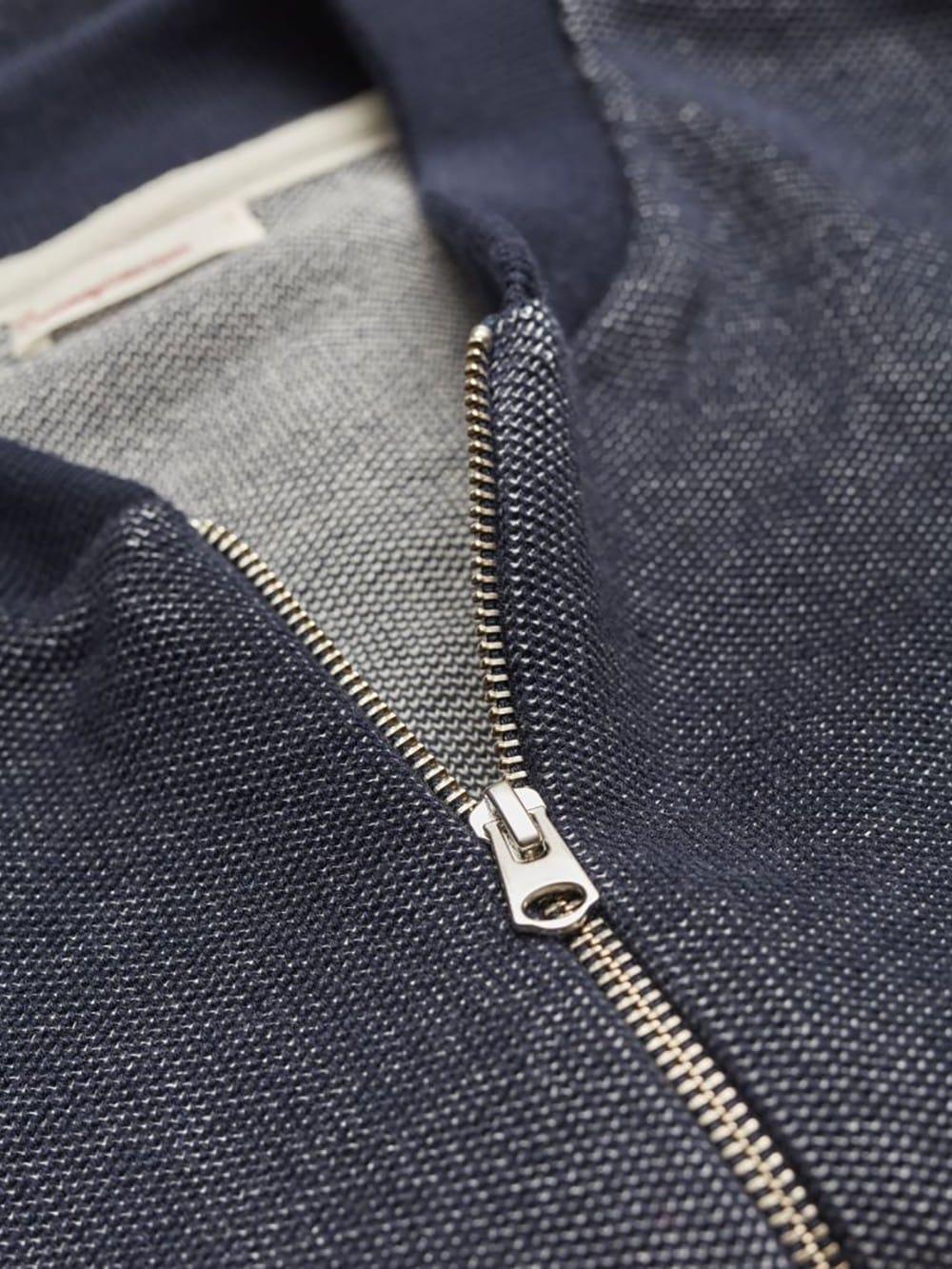 Blue jacket with organic cotton zip