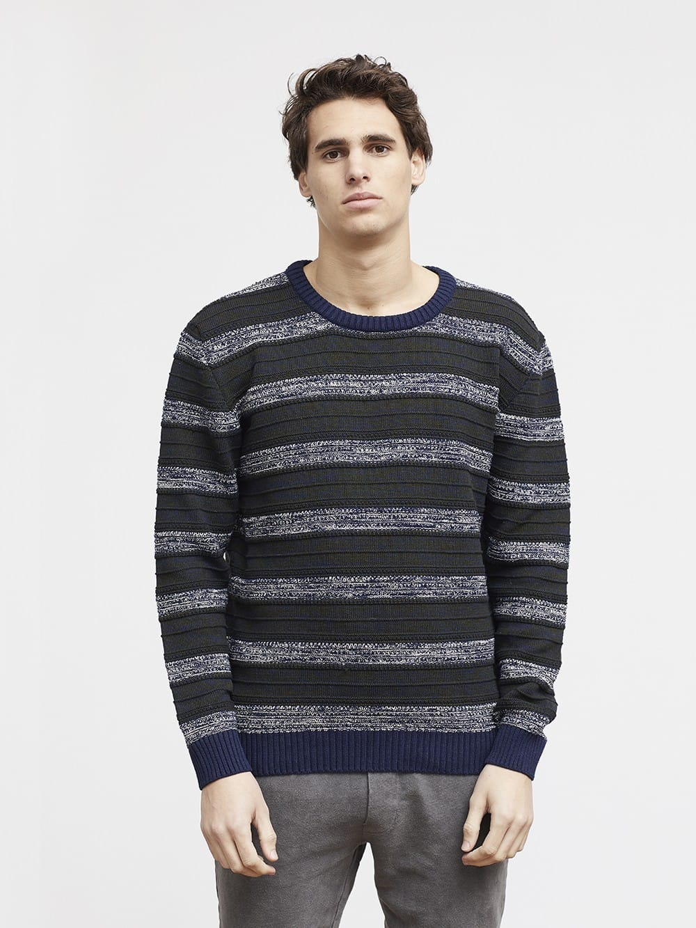Green sweater with stripes made of recycled materials